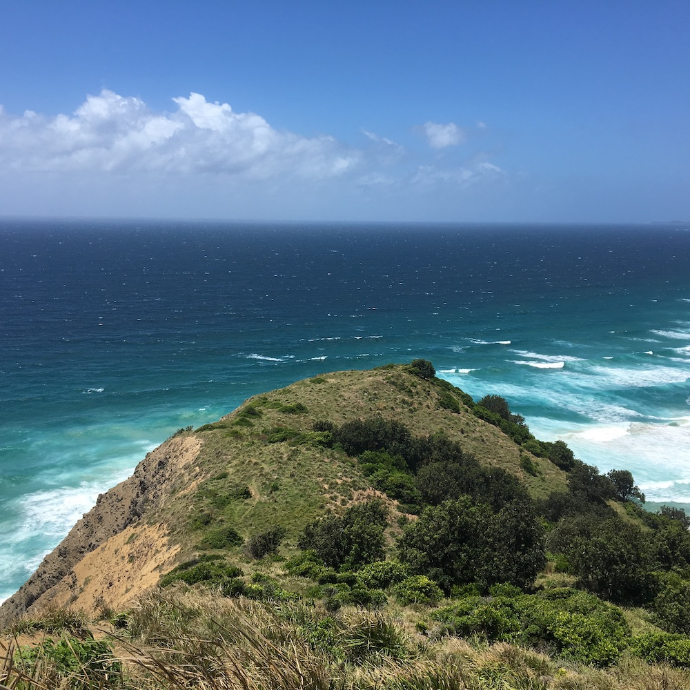The photo captures the beautiful scenery of the ocean at Byron Bay, New South Wales, Australia.